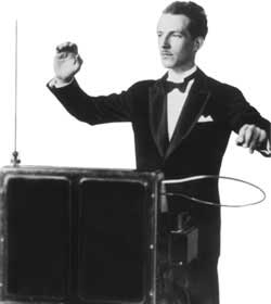 Leon Theremin playing one.